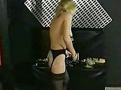 Slave with tiny tits walking around with large metal clamps