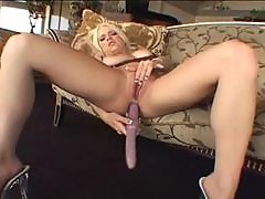 Blonde girl with small tits has fun anal with toys