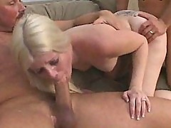Blonde Slut Takes A Cum Shower in Gangbang Encounter