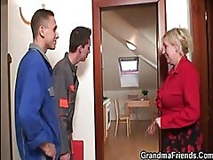 Two repairmen bang busty grandma ...