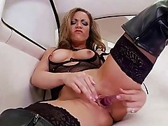 Girl in latex boots masturbating