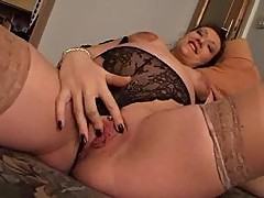Solo pregnant hottie uses a toy for fun