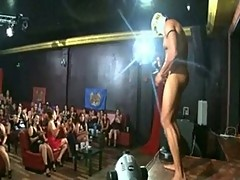 Ladies in the crowd engulfing a stripper's hard penis