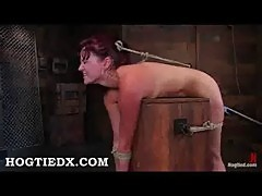 Hogtied redhead gets vibrated