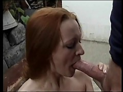Red head gives blowjob outside cottage