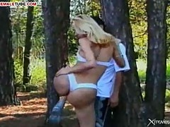 Outdoor sex with blonde tranny in the forest
