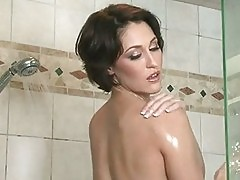 Sexy short haired Ryan Keely soaking her naked body wet in t...
