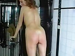 Horny slave with clit piercing is spanked on her butt by ang