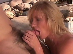 Blonde hottie sucks mans sleeping cock