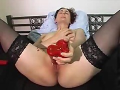 Horny milf jilling off with red sex toy