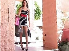 A bold and sexy brunette undress in public places