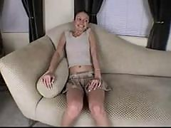 Hailey Young masturbating on a big sofa