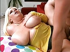 Chubby blonde honey with massive jugs doing titjob