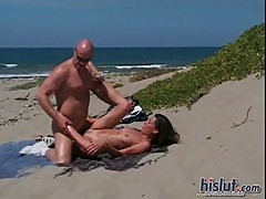 Monique fucks on the beach