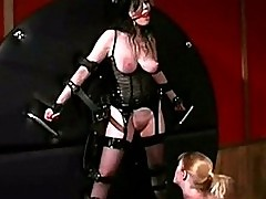Busty girl in corset tied to wall getting her tits rubbed ot