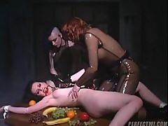 Girl tied to the table and groped by rubber chicks