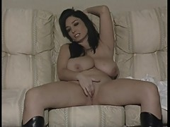 British slu Michelle plays with herself in boots on the sofa