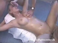 Oiled up bitch fucke by two men in the shower room