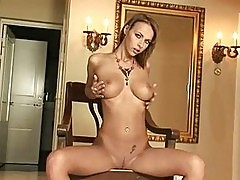 Busty tanned brunette with shaved pussy showing her beaver