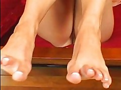Blonde with sexy curves and foot fetish rubs her shaved nook...