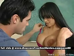 Busty brunette teacher on the desk